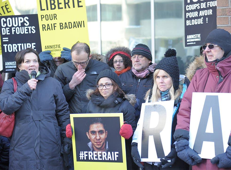 Ensaf Haidar, centre, wife of the Saudi blogger Raif Badawi, holds a vigil in Montreal, Quebec, urging Saudi Arabia to free her husband