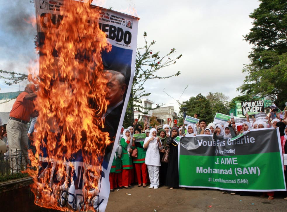 Protesters in Marawi, Philippines, burn a poster with the face of Israeli Prime Minister Benjamin Netanyahu