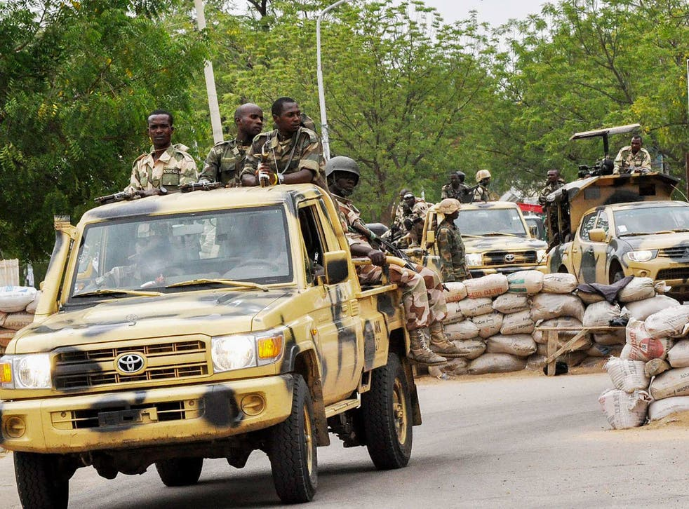 Members of the Nigerian military patrolling in Maiduguri, North East Nigeria, close to the scene of attacks by Boko Haram
