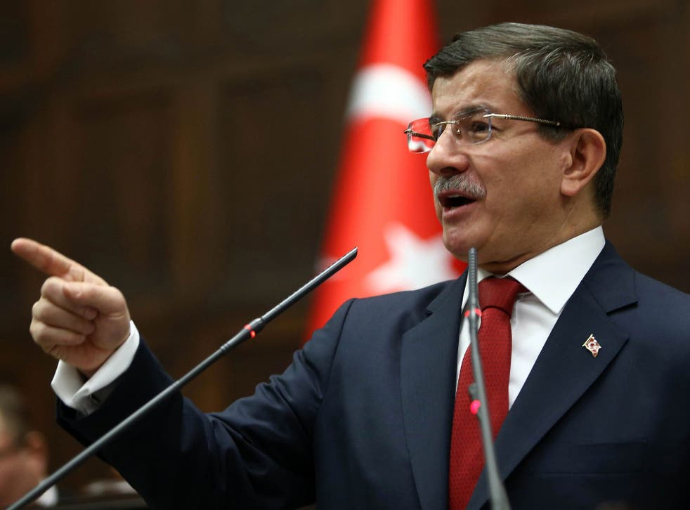 Turkey's Prime Minister Ahmet Davutoglu speaks during the parliamentary group meeting of Turkey's ruling Justice and Development Party at the Grand National Assembly of Turkey on January 13, 2015