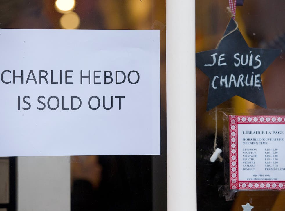 A sign that reads 'Charlie Hebdo Is Sold Out' is seen in the window of a French book shop, earlier selling the satirical magazine Charlie Hebdo, in London