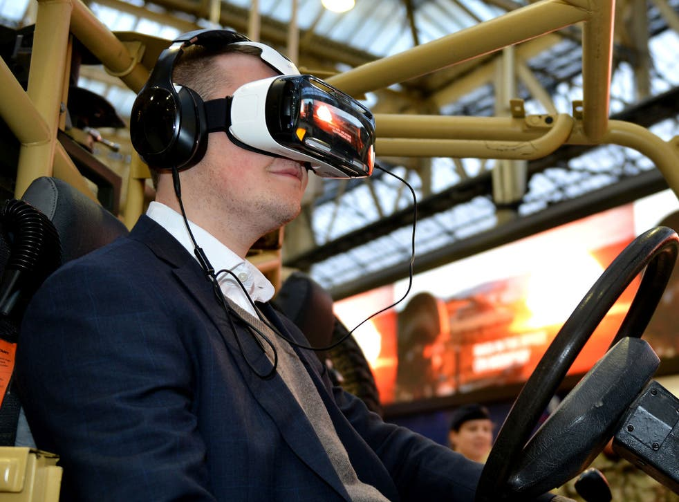 Sergeant Rupert Frere tries the Army s new Oculus Rift technology - wrap-around virtual reality headsets which will let potential new recruits experience the sensations of being on training exercises and operations in the UK and abroad