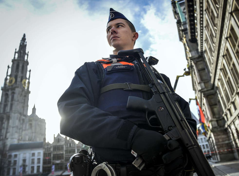 A police officer in front of Antwerp cathedral yesterday