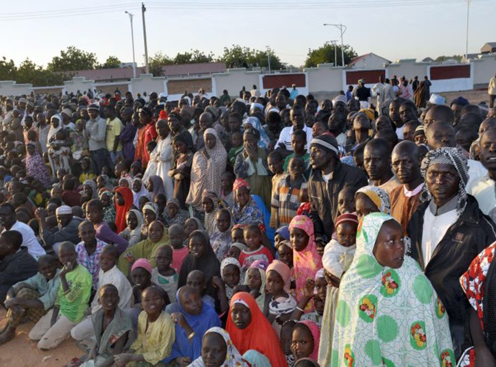 Displaced people from Baga listen to Goodluck Jonathan after the Boko Haram killings (AFP/Getty)