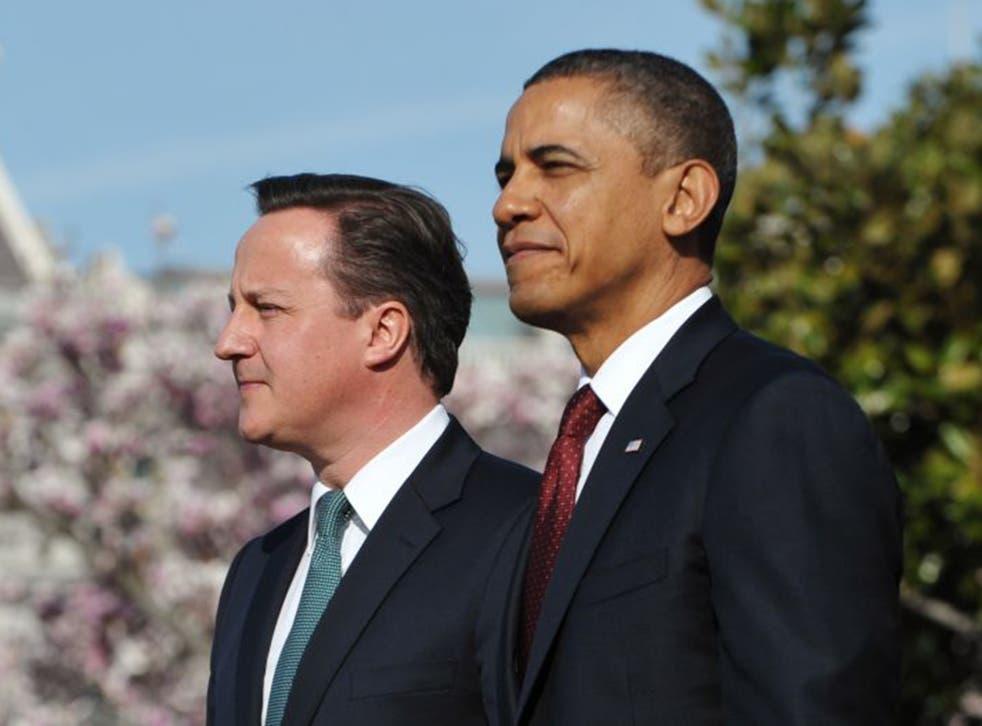 David Cameron and Barack Obama have pledged to work together (AFP/Getty)