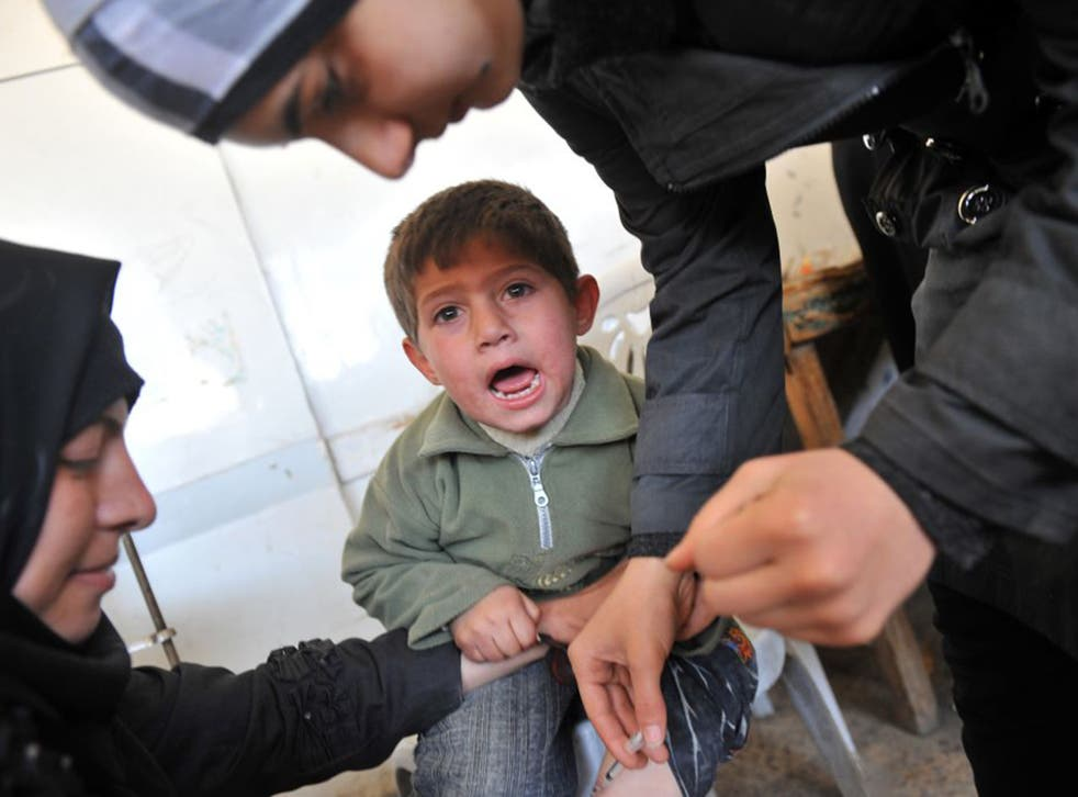 Innoculating a Syrian child against the disfiguring disease leishmaniasis in Aleppo (AFP/Getty)