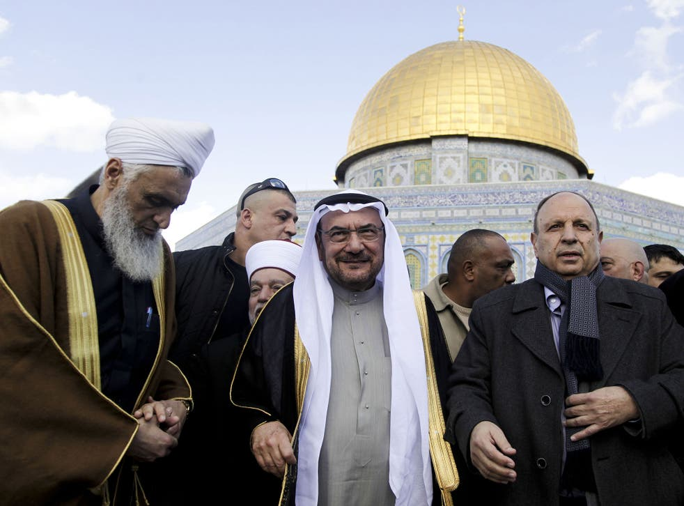Saudi Arabia's Iyad Madani, the Secretary-General of the 57-nation Organisation of Islamic Cooperation, stands in front of the Dome of the Rock shrine in Jerusalem