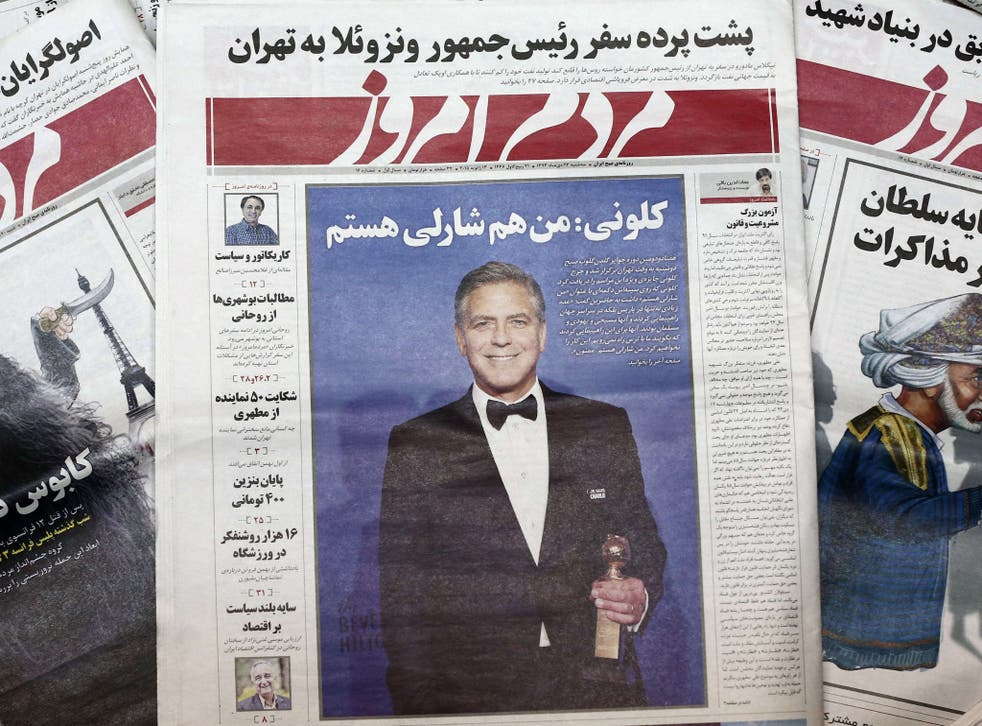 A picture taken in Tehran shows copies of the headline of Iranian reformist newspaper Mardom-e Emrouz (People of Today)