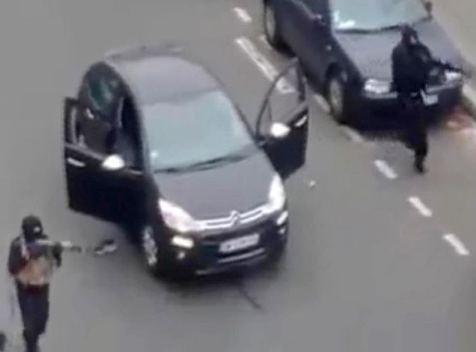The two brothers stormed the Charlie Hebdo headquarters, opening fire on staff, before executing an already injured police officer as they fled (AP)