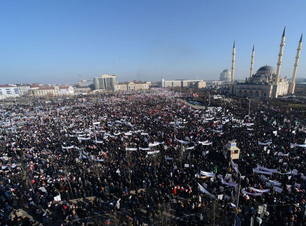 People attend a state-organised rally against the publication of cartoons of the Prophet Mohamed by Charlie Hebdo in the Chechen capital Grozny on 19 January
