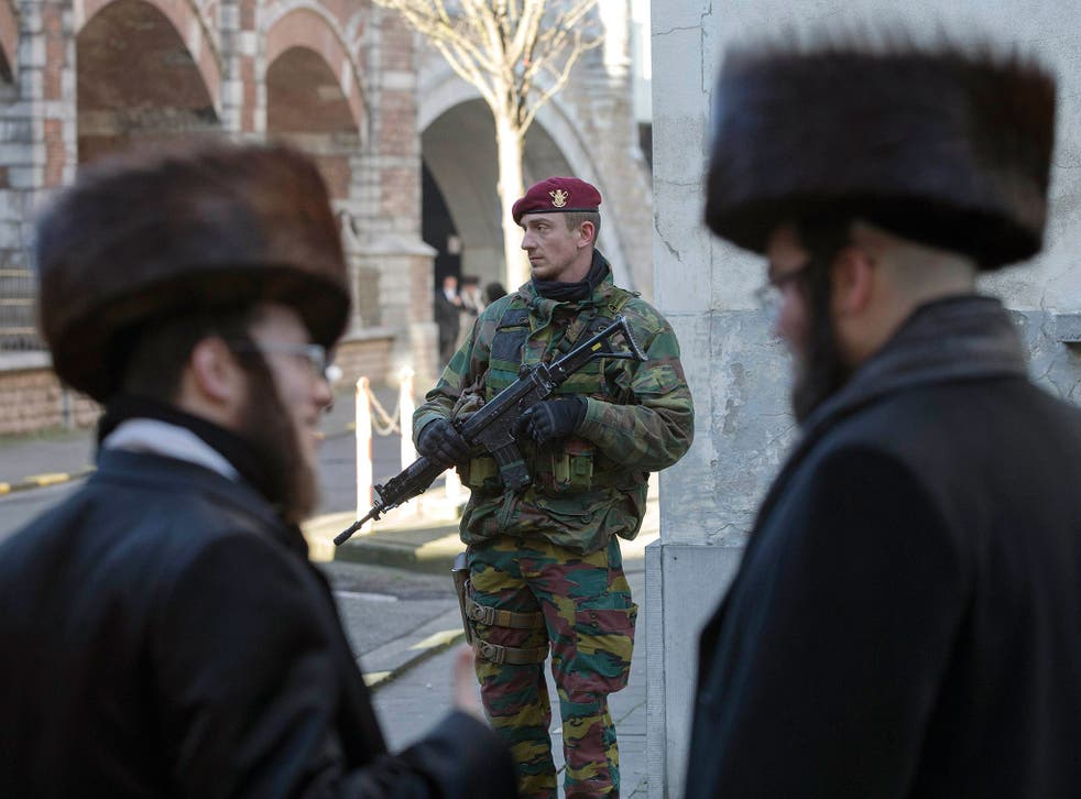 A Belgian paratrooper guards a Jewish school in Antwerp at the weekend, as security was tightened in major Belgium towns following the foiled terror plot in Verviers