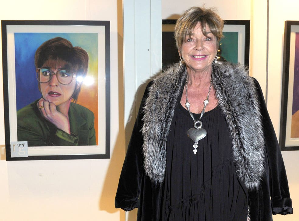 Anne Kirkbride with a portrait of a young Deirdre Barlow at The Richard Goodall Gallery, Manchester, on 2 December 2010