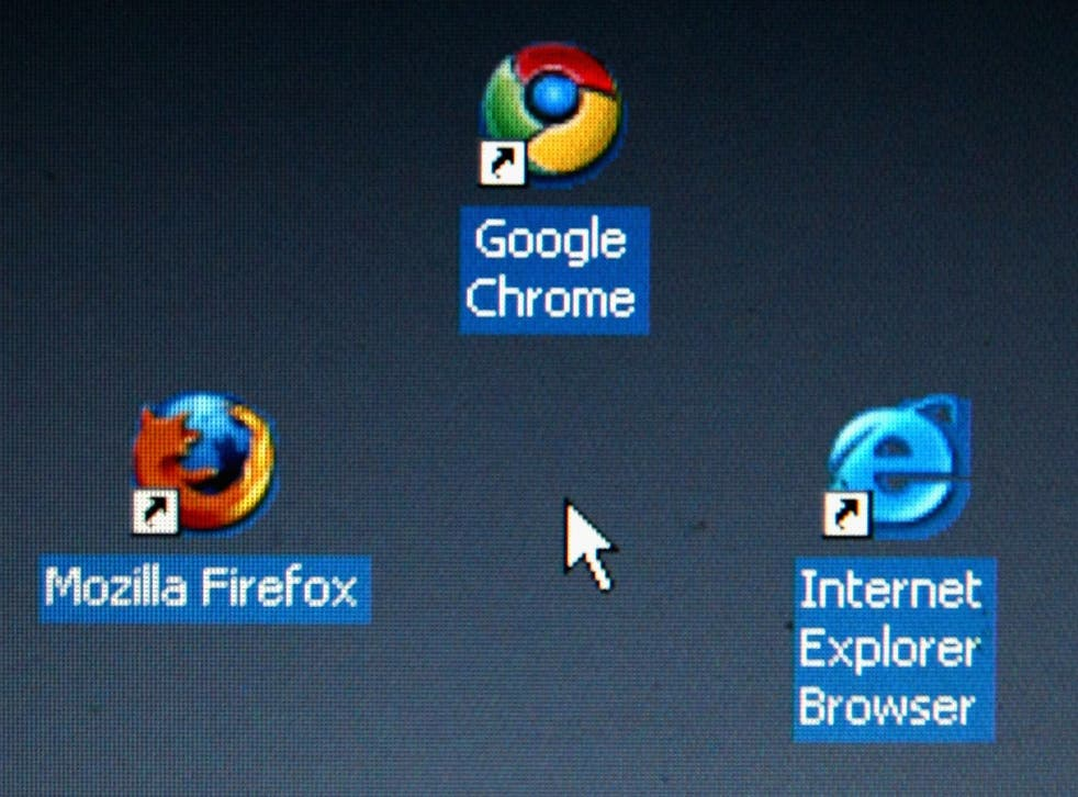 Google's Chrome browser shortcutis displayed next to Mozilla Firefox shortcut and Microsoft's Internet Explorer browser shortcut, on a laptop