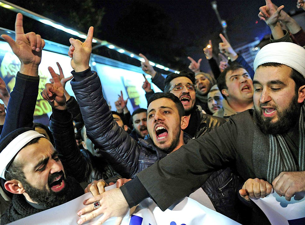 Muslims in Istanbul protest against a Turkish newspaper's publication of anti-jihadist cartoons from the French satirical magazine 'Charlie Hebdo'