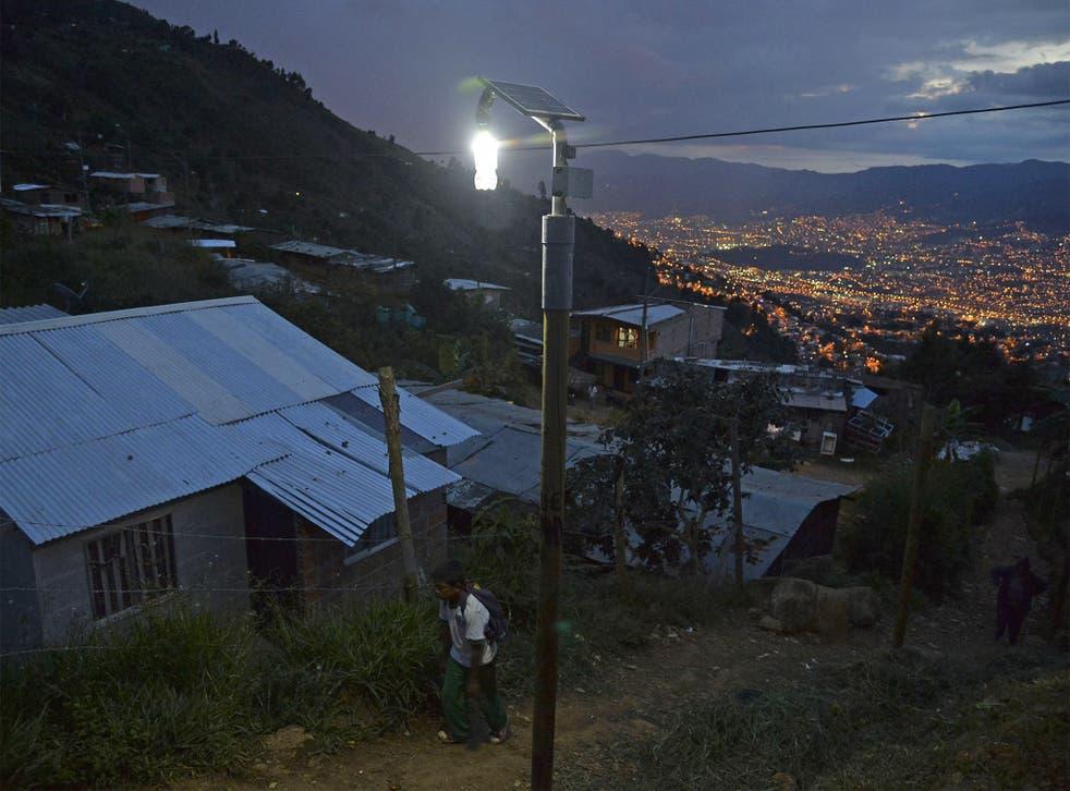 Shine on: a 'Liter of Light' plastic bottle provides illumination in the Granizal area of Antioquia, Colombia