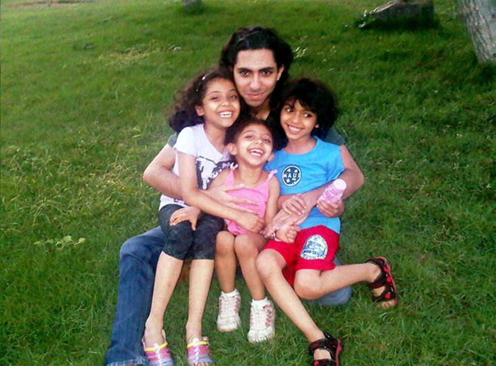 Jailed blogger Raif Badawi, pictured with his children