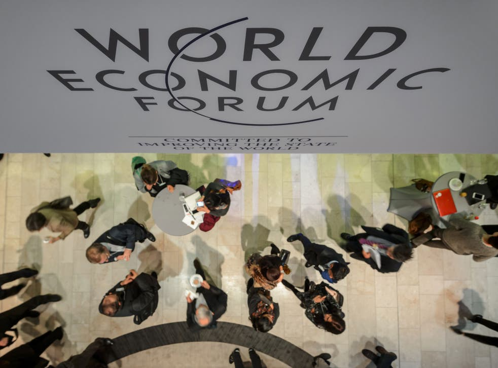 Participants are seen at the Congress Center during the World Economic Forum (WEF) annual meeting on 21 January, 2014, in Davos