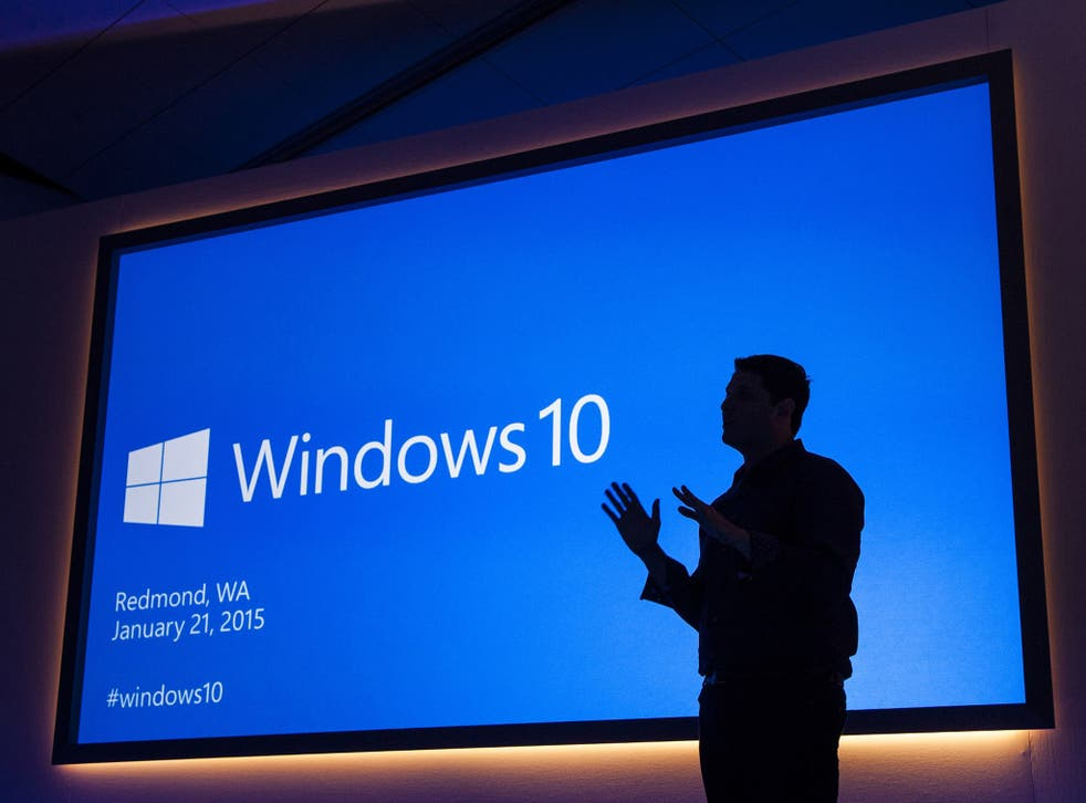 Terry Myerson silhouetted against the backdrop at the Windows 10 launch event