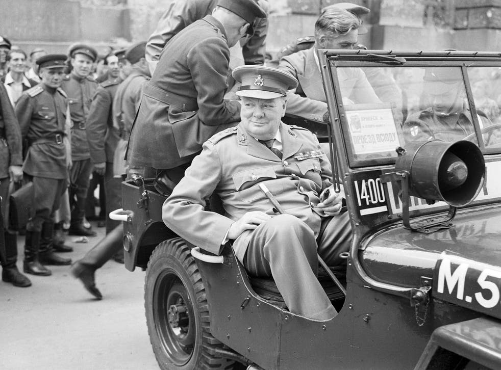 Winston Churchill outside the German Reichstag during a tour of the ruined city of Berlin on 16 July 1945