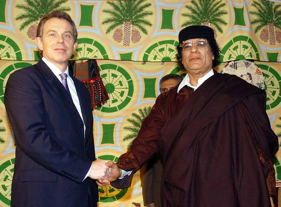 British Prime Minister Tony Blair (L) pictured shaking hands with Libyan leader Colonel Moamer Kadhafi on 25 March 2004.
