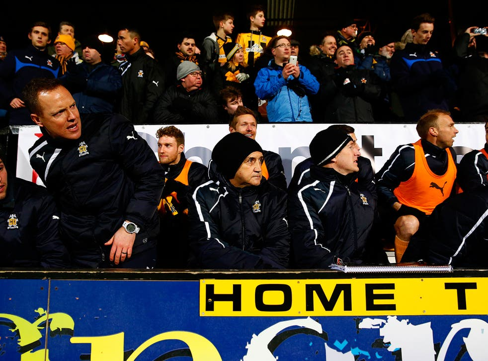 Richard Money watches on during Cambridge United's 0-0 draw with Manchester United