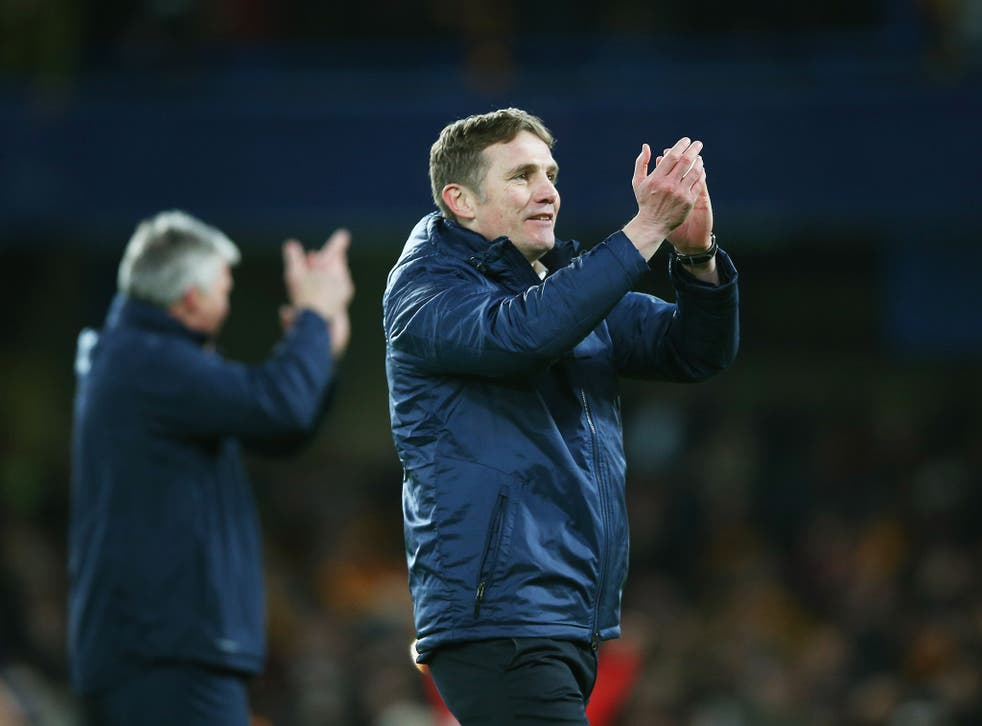 Manager Phil Parkinson applauds the Bradford support