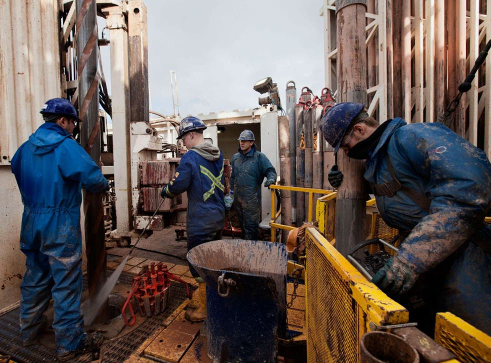 Engineers on a drilling platform extracting fossil fuels