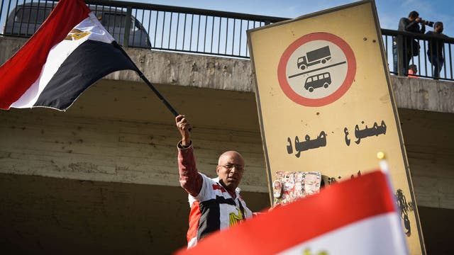 A supporter of Egyptian President Abdel Fattah al-Sisi waves his national flag during a demonstration in Cairo on January 25, 2015