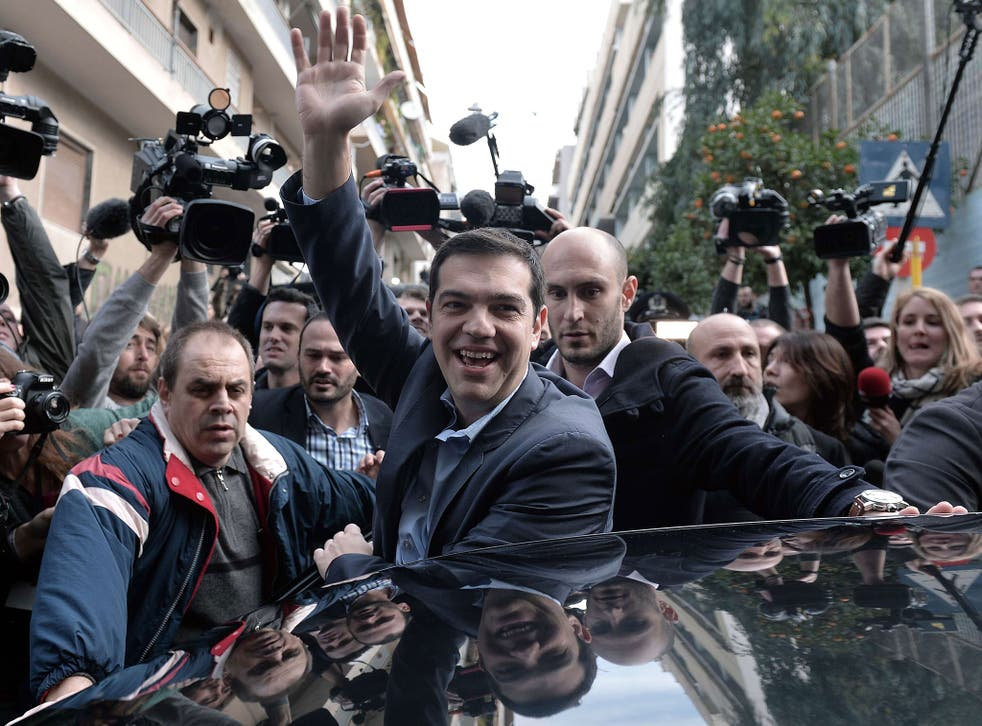 Alexis Tsipras, leader of the Syriza party,  greets supporters after casting his vote in Athens for  Greece's general elections on January 25, 2015