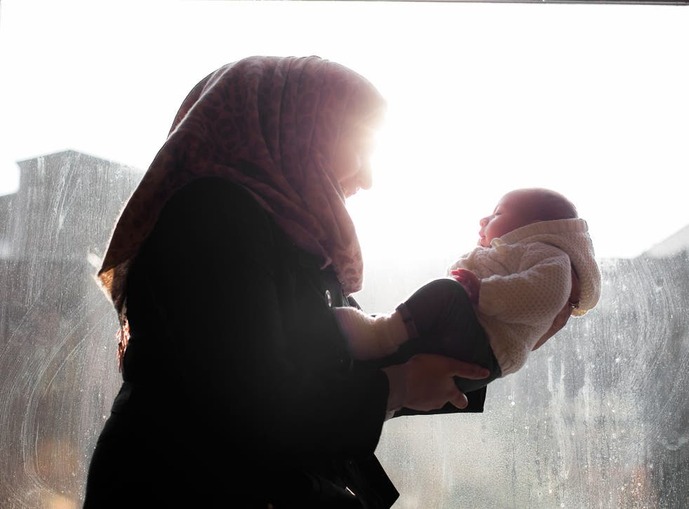Syrian refugee 'Nour' with her two month-old daughter. She was one of the first Syrians to come to the UK when the Government agreed to resettle 100 people from the country
