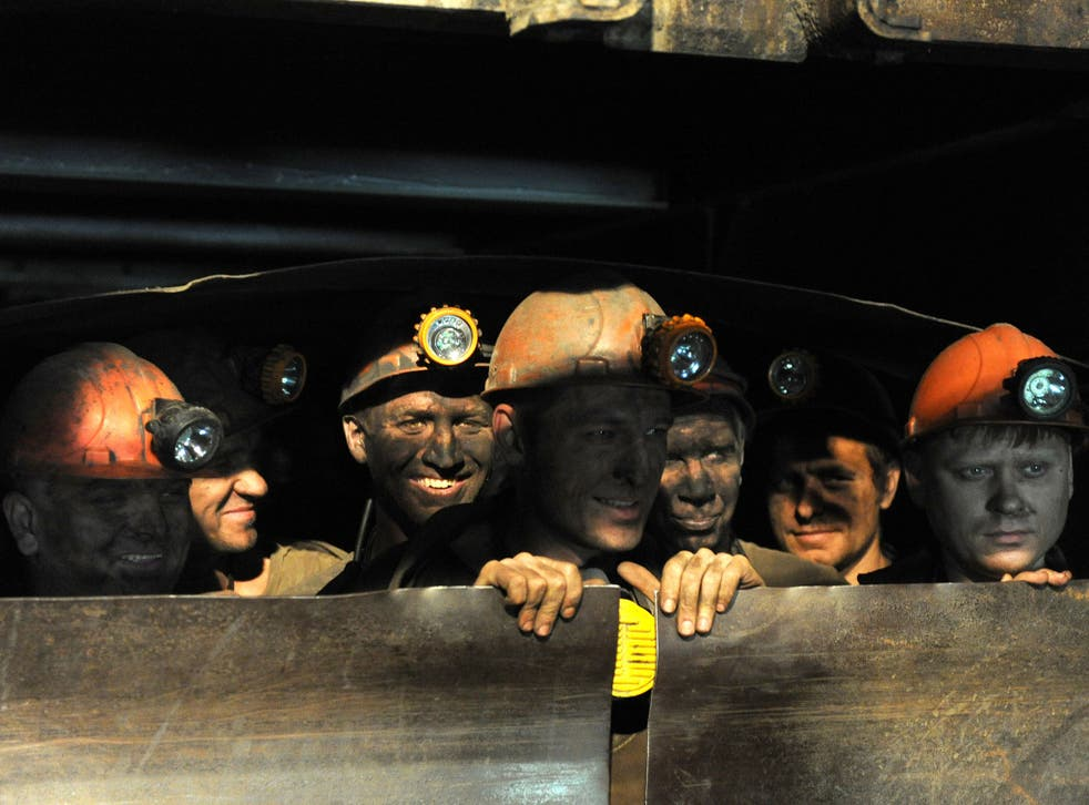 Coal miners take an lift out of the Zasyadko mine in Donetsk in June 2014
