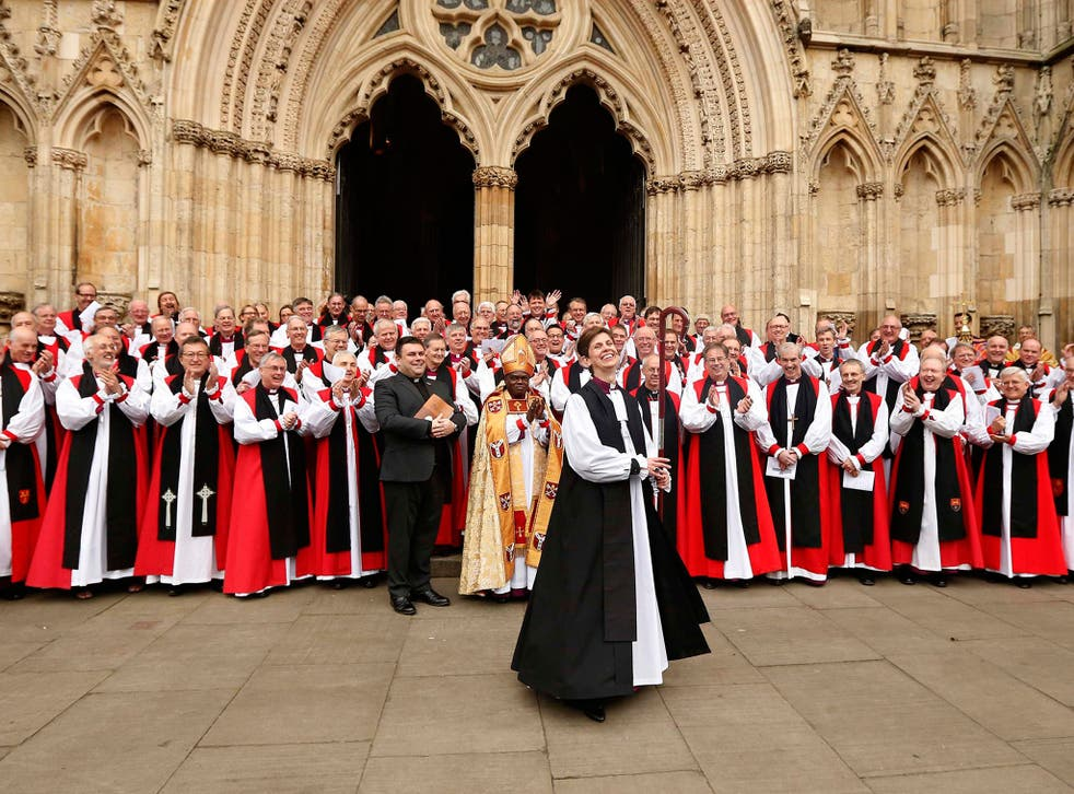 Libby Lane, the first female bishop in the Church of England, smiles following her consecration service at York Minster in York