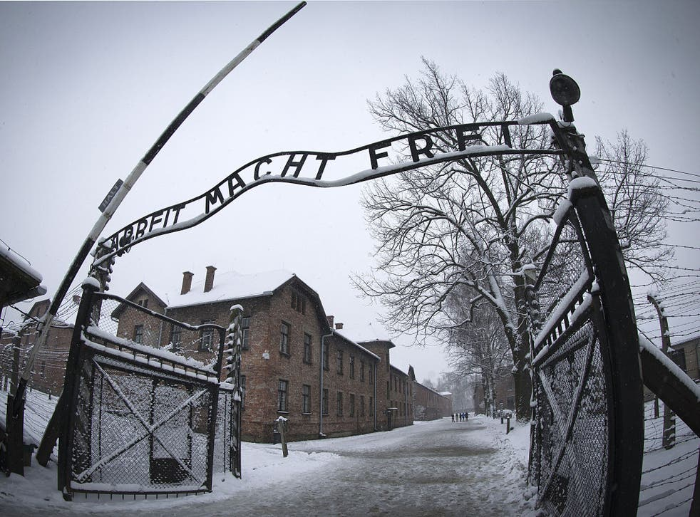 The entrance to the former Nazi concentration camp Auschwitz-Birkenau with the lettering 'Arbeit macht frei' ('Work makes you free')