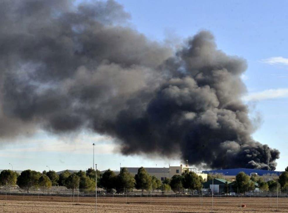 Smoke rises after a Greek F-16 aircraft crashed at Los Llanos air base in Albacete