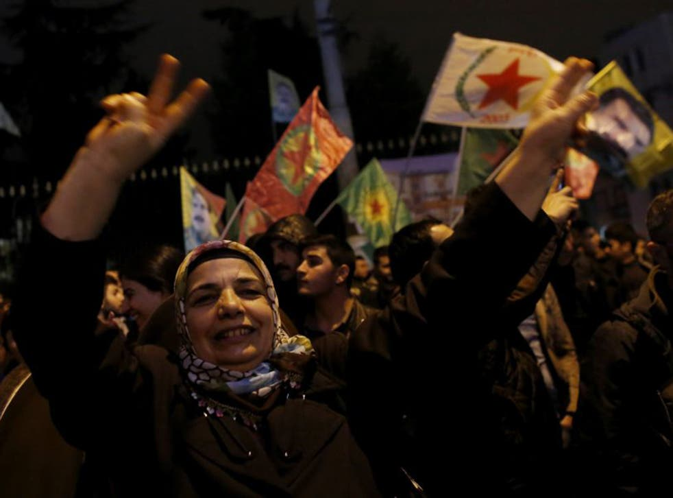 Pro-Kurdish demonstrators celebrate in central Istanbul, after Kurdish forces took full control of the Syrian town of Kobani (Reuters)