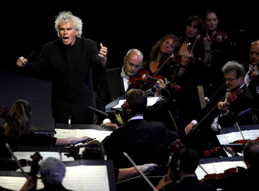 Baton charge: Simon Rattle conducting the LSO in 2012