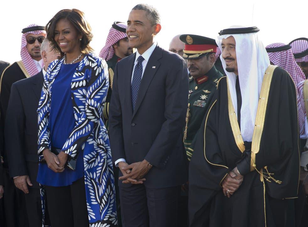 President Barack Obama and first lady Michelle Obama stand with new Saudi King Salman bin Abdul Aziz