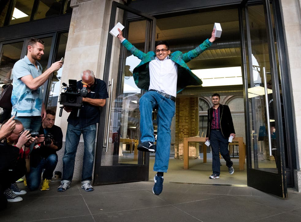 How do you like them Apples?: a happy customer celebrates after being the first person to purchase the iPhone 6 in London, last September