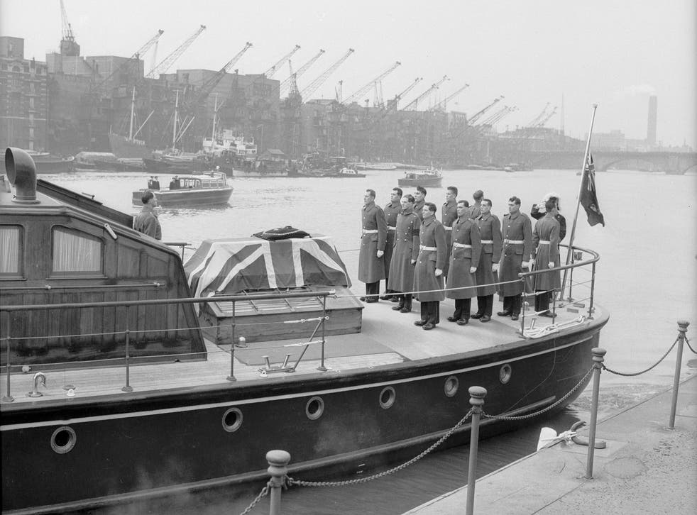The cranes are lowered by dock workers after Winston Churchill's funeral, 30 January 1965