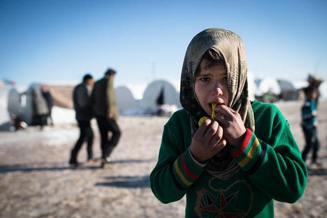 A young Syrian refugee in a makeshift camp
