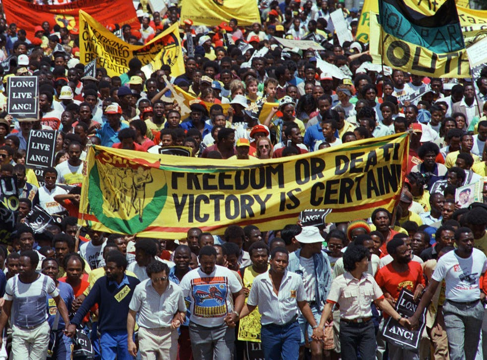 Demonstrators hold an anti-apartheid protest march through Johannesburg on 14 October 1989