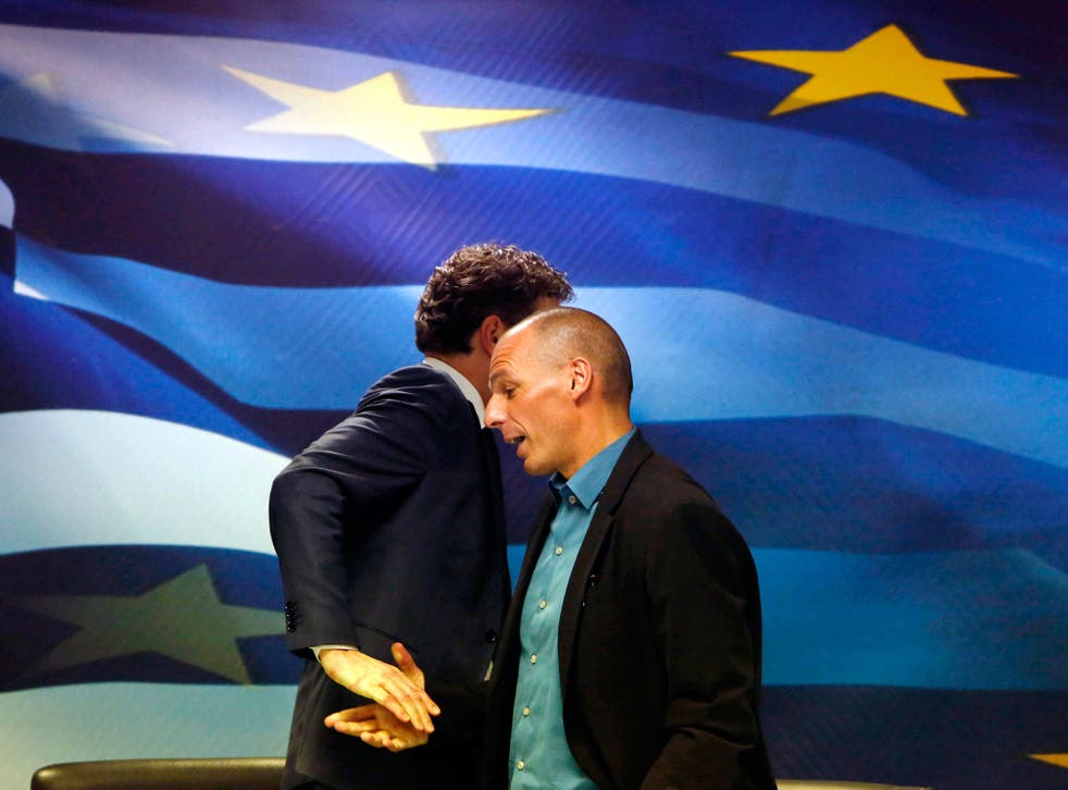 Jeroen Dijsselbloem, (L) head of the euro zone finance ministers' group, and Greek Finance Minister Yanis Varoufakis shake hands after their common press conference at the ministry in Athens. Greece's government will not cooperate with the EU and IMF miss
