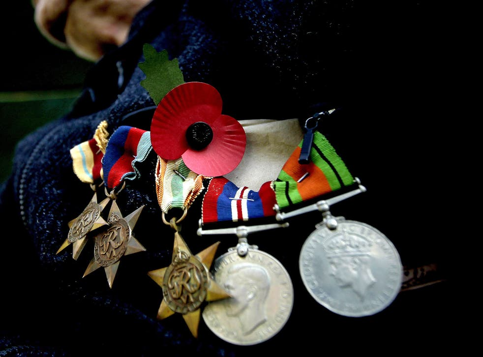 A military charity has warned of people pretending to be decorated veterans