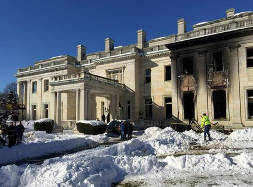 Fire has badly damaged built in 1916 by the Woolworth family