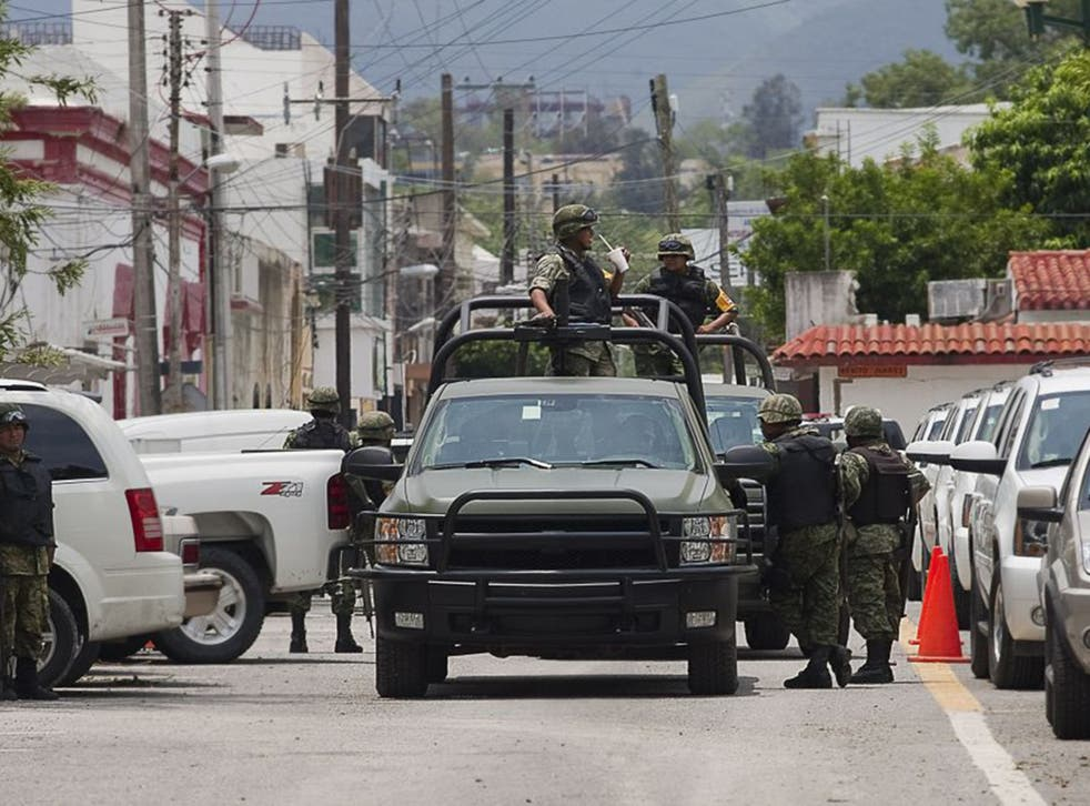 Mexican soldiers on patrol in the cartel stronghold of Ciudad Victoria (AFP/Getty)