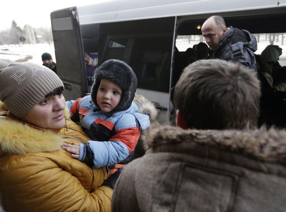 Civilians in Debaltseve board an evacuation bus on Saturday (AP)