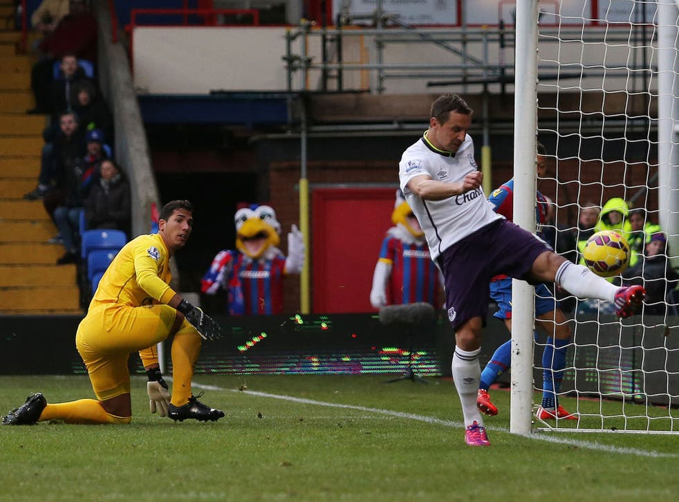 Everton's Phil Jagielka clears off the line against Palace