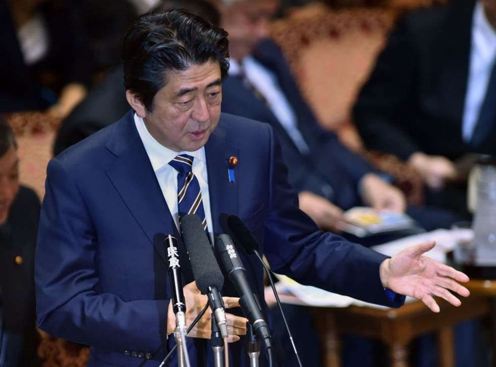 Japan's Prime Minister Shinzo Abe has announced $200m (£133m) in non-military aid for the fight against Isis (AFP)