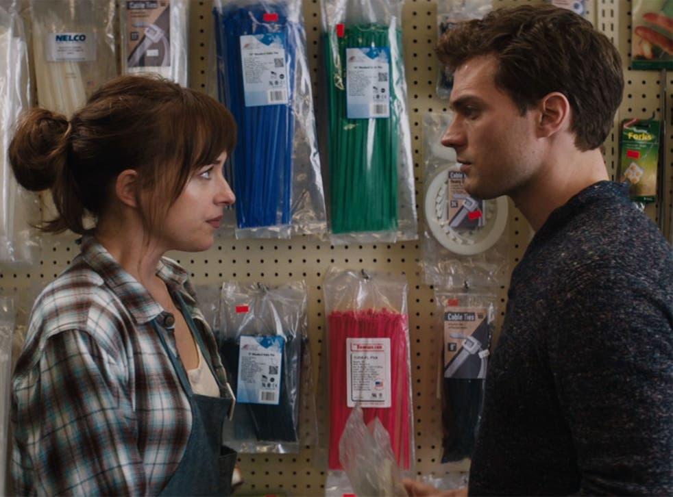 Jamie Dornan and Dakota Johnson as Christian Grey and Anastasia Steele in Fifty Shades of Grey