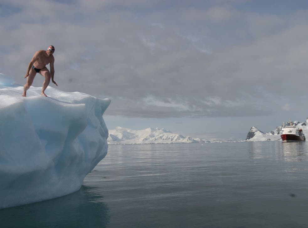 """Lewis Pugh diving into the Artic Ocean, as the British endurance swimmer is embarking on one of the """"most dangerous swims ever undertaken in the world"""""""